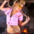 Stock Photo: Attractive girl inside of dirty workshop