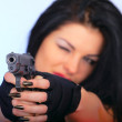 Attractive girl with hand gun — Stock Photo #10031554