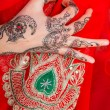 Stock Photo: Hand with traditional indiornament