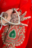 Hand with traditional indian ornament — Stock Photo