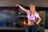 Attractive girl in the smithy — Stock Photo