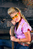 Attractive girl in the smithy — Foto Stock