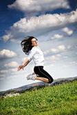 Jumping woman — Zdjęcie stockowe