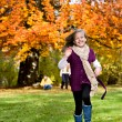 Girl in the autumn park - Stock Photo