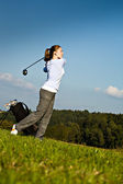 Playing golf — Stock fotografie