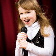 Girl with microphone — Stock Photo #8071451