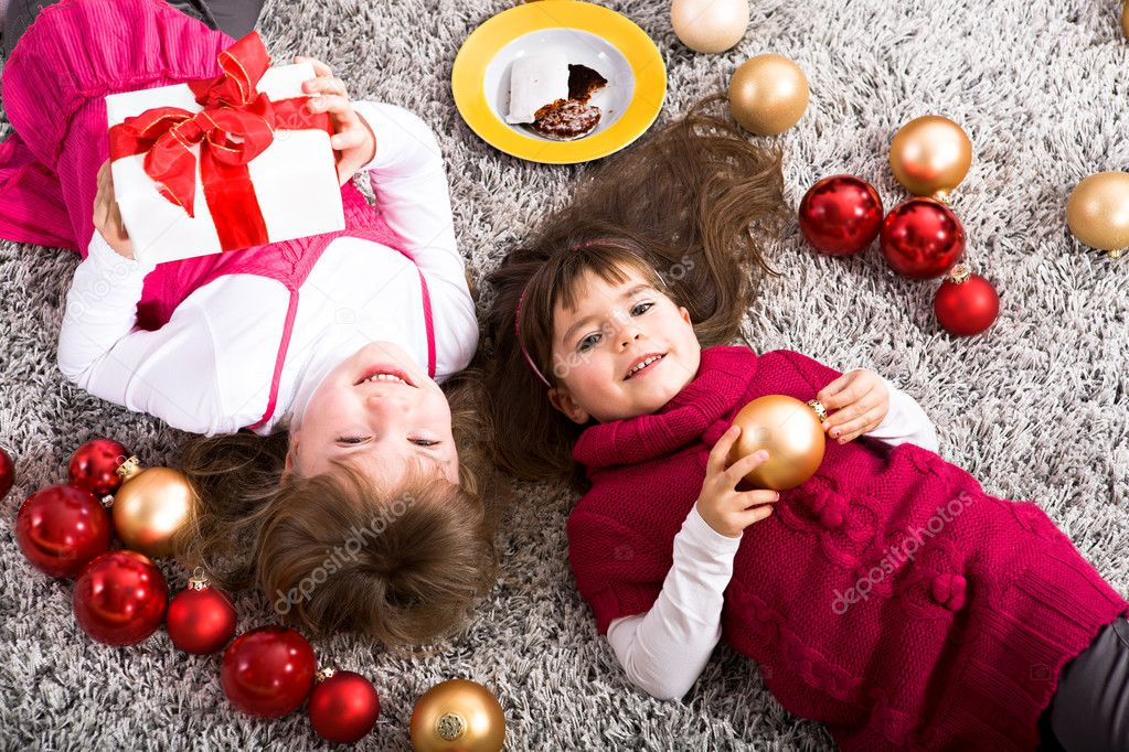 Little girl getting a Christmas gift — Stock Photo #8071761