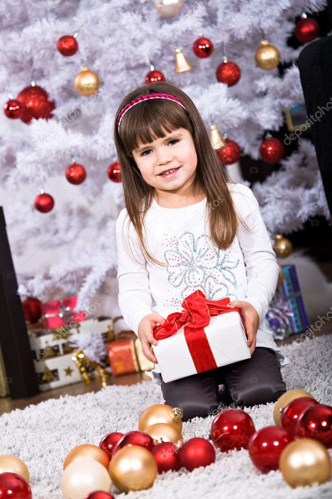 Little girl geting a Christmas gift  Stock Photo #8072129
