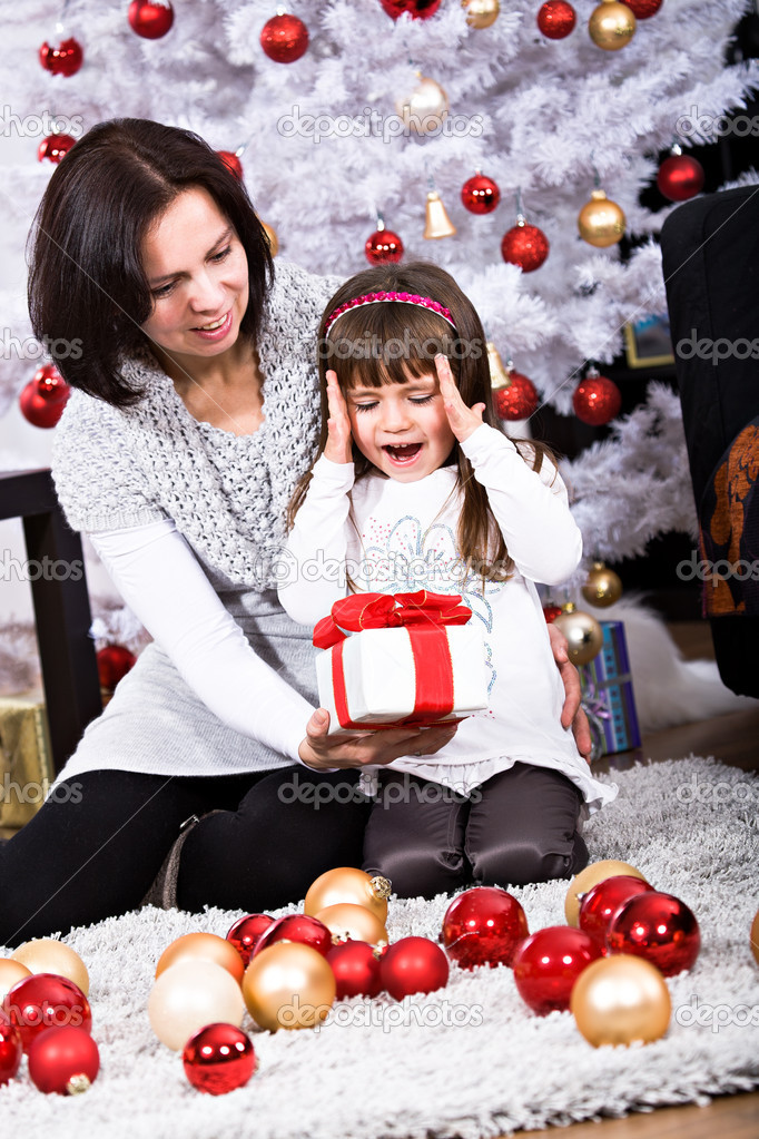 Little girl geting a Christmas gift — Photo #8072146