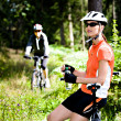 Foto Stock: Cycling woman