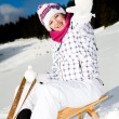 A young woman sledging in the Alps, an outdoor shoot. — Stock Photo #8561991