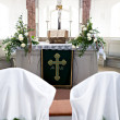 Holy Bible and Flowers on altar in the church - Stock Photo