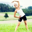 Stretching woman — Stock Photo
