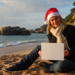 Christmas beach ad — Stock Photo