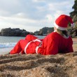 Santa's helper on vacation — Stock Photo