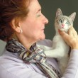 Portrait of senior woman and her cat — Stock Photo