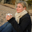 Enjoying a coffee at the beach — Stock Photo #8384213