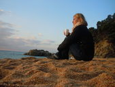 Contemplating at the beach — Stockfoto