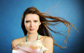 Girl with shell — Stock Photo