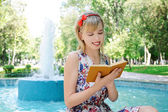Beautiful girl with a book — Stock Photo