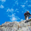 Climber on the mountain summit — Stock Photo