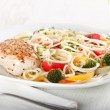 Pasta and chicken breast — Stock Photo