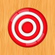 Red target on the wooden wall — Stock Vector