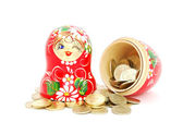 Russian doll with russian rubles coins — Stock Photo
