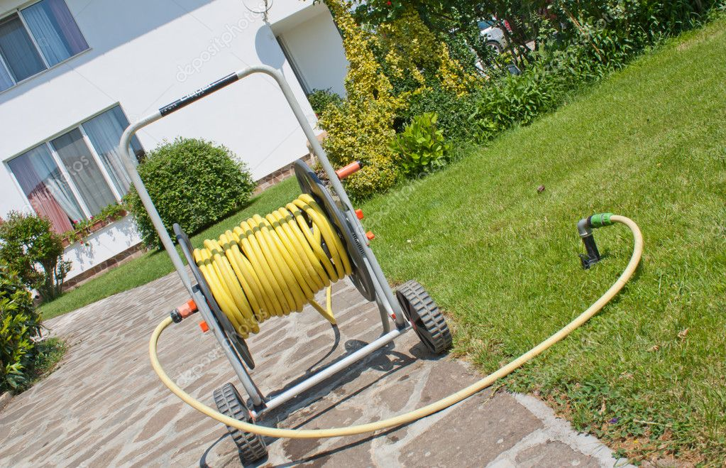 garden hose sprinkler system — Stock Photo #8275685