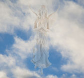 Angel in the clouds — Stock Photo