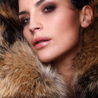 Portrait of a young fashion model wearing fox fur smoky eyes — Stock Photo #10260725