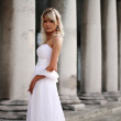 Young beautiful blonde bride portrait standing on a staircase of a classical building — Stock Photo #10262838