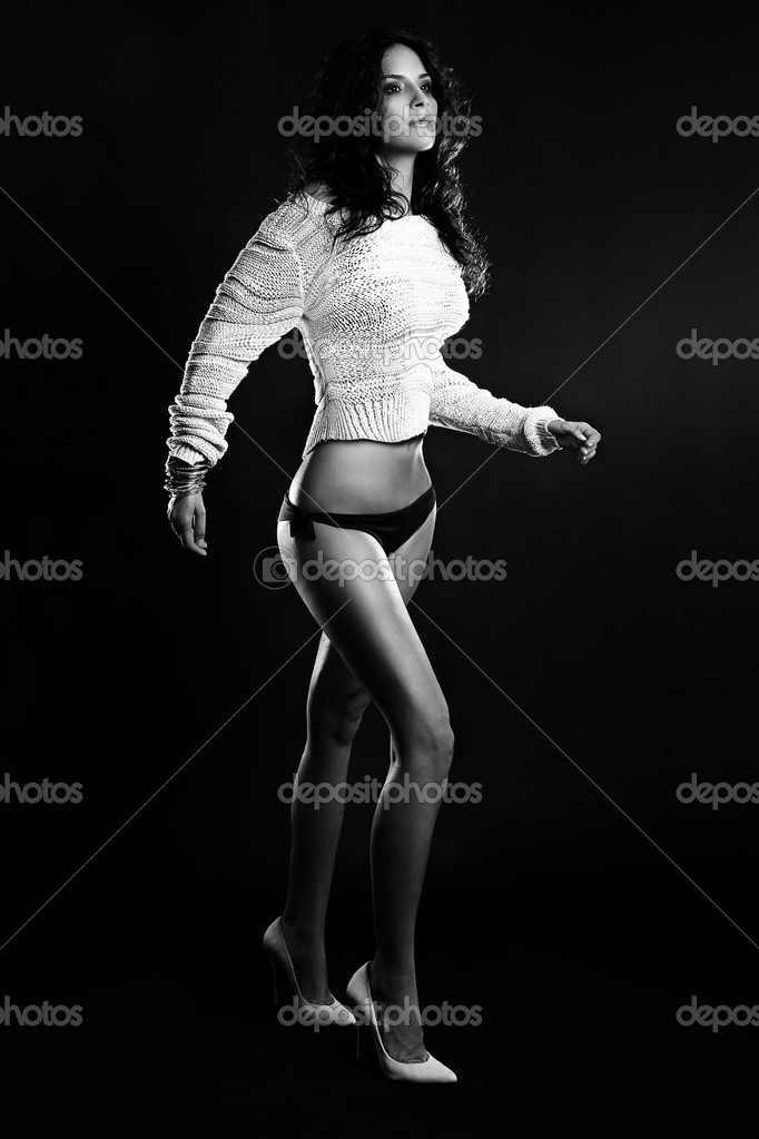 Fashion Italian brunette model in a sexy fashion dress posing on dark background — Stock Photo #10260451