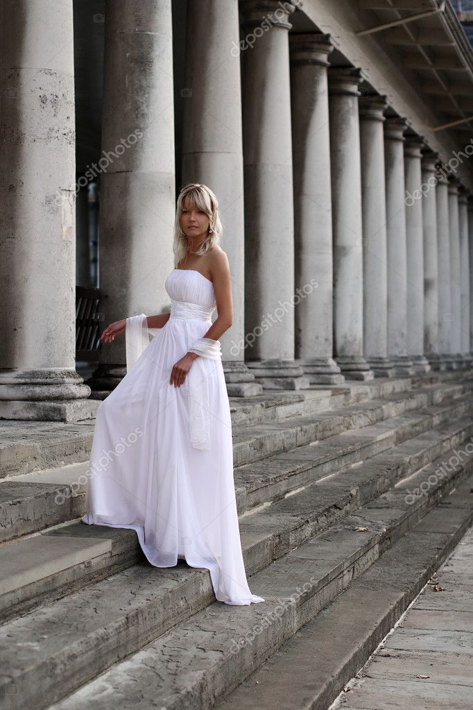 Young beautiful blonde bride portrait standing on a staircase of a classical building  Stock Photo #10262825