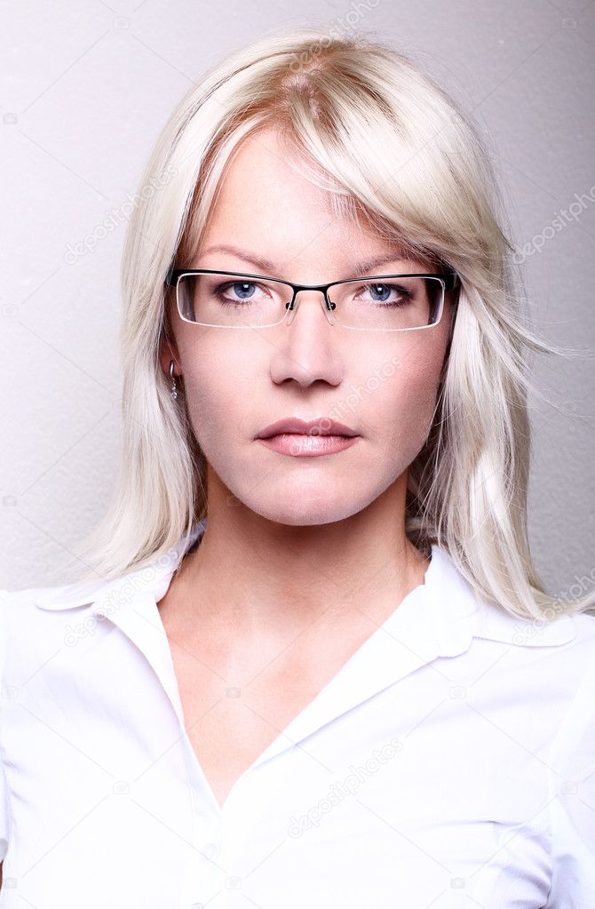 Young attractive business women smiling wearing glasses holding a folder in an office environment  — Stock Photo #10262913