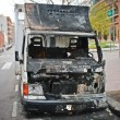 Stock Photo: Burning truck (vandalism)
