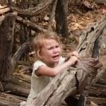 Little child crying on the bridge — Stock Photo