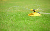 Installation of water sprays on green lawn — Stock Photo