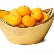 Mandarin oranges in gold ingot container - Photo