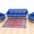 Foto Stock: Interior with Blue Sofand Carpet
