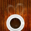 Vector coffee cup on wooden background with smoke in the form of heart. Eps10 — Stock Vector
