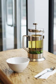 French-press with green tea on the table — ストック写真
