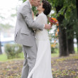 Stockfoto: Bride and groom kissing