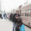 Стоковое фото: Happy young couple on railway station platform