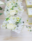 Delicious white and yellow artificial flowers — Stock Photo