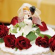 Figurines on top of wedding cake — Stock Photo #9698361