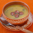 Cream soup with cut sausage in the bowl - Stock Photo