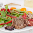 Boiled meat with sausages and vegetable salad — Stock Photo
