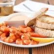 Shrimps with sauce and bread — Stock Photo #10585054