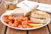Shrimps with sauce and bread — Stock Photo